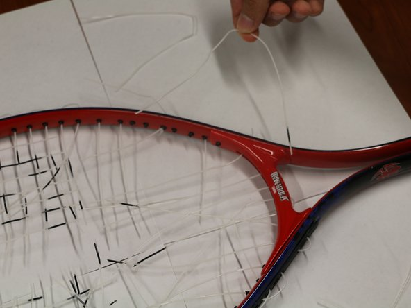 Remove the strings by pulling from the outside of the racket.