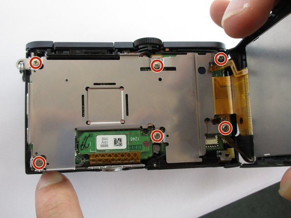 Lift up the screen, and use a Phillips #000 screwdriver to remove the (6) six screws holding down the underlying metal plate.