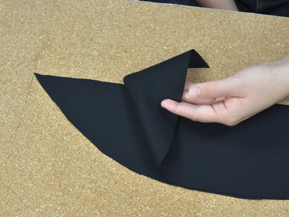 Lay the two pieces of fabric with the right sides together.