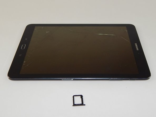 Insert the Micro SD Card in the plastic insert, and replace it into the device.