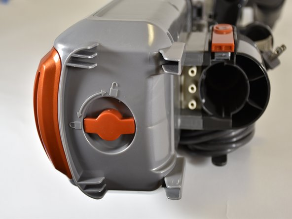 Locate an orange dial at the bottom of the  now-separate body of the vacuum.