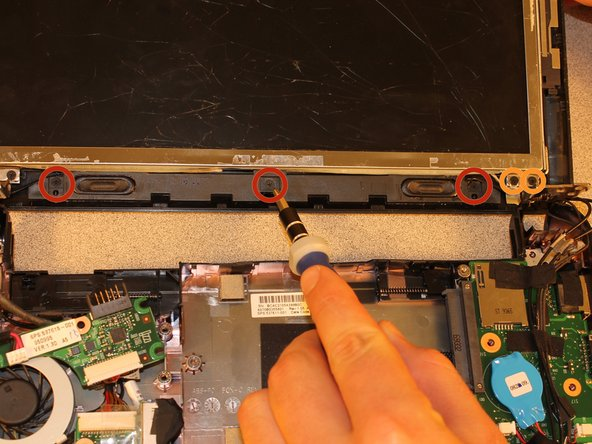 Image 1/3: Remove the two 2.9mm PH0 screws that hold the lid to the screen. This will allow you to extract the speaker wire from behind the hinge.