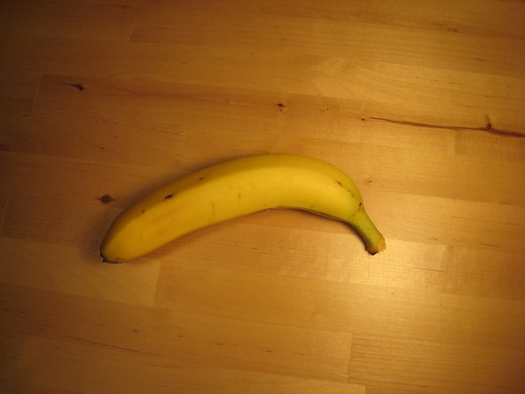 Hold the banana in your left hand and grip the stem between your right thumb and forefinger.