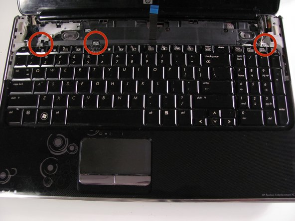 Remove the three silver Phillips 3.5mm screws that secure the keyboard to the computer.