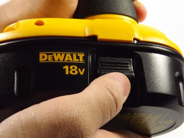 Compress the buttons on either side of the battery and lift the drill away from battery.