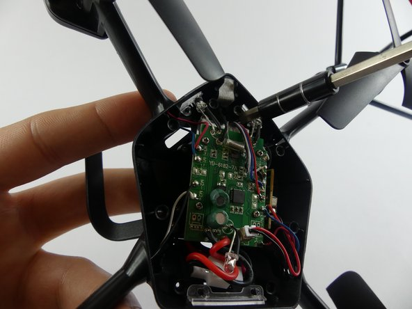 Remove the two 5.2mm screws holding the landing gear in place using a Phillips 00 screwdriver and an extension if needed.