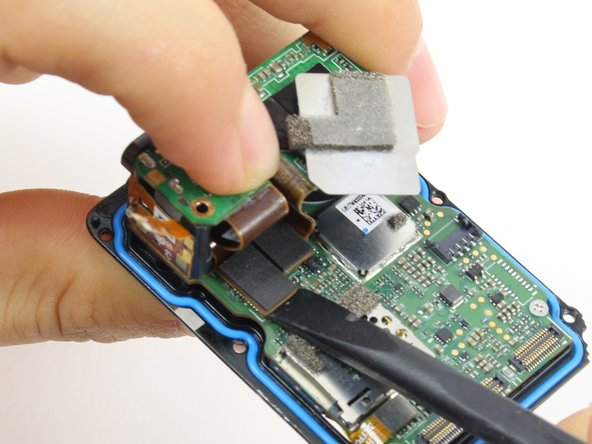 Use the flat end of the spudger to pry the charging port ribbon cable connector straight up from its socket on the motherboard.