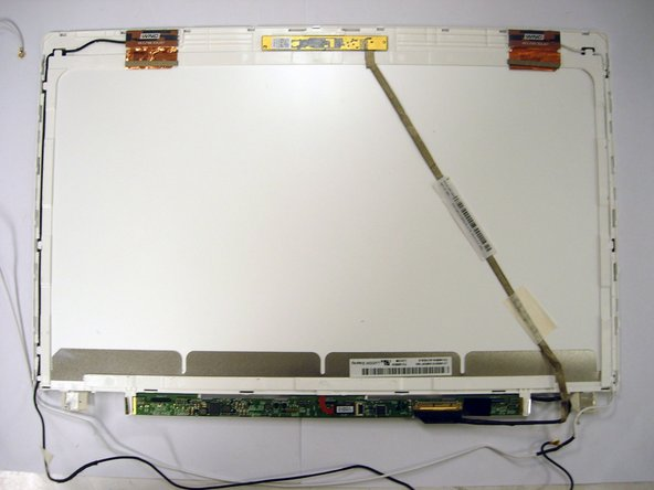 The third image is of the screen itself from the backside. Here we see the wireless cables and webcam.