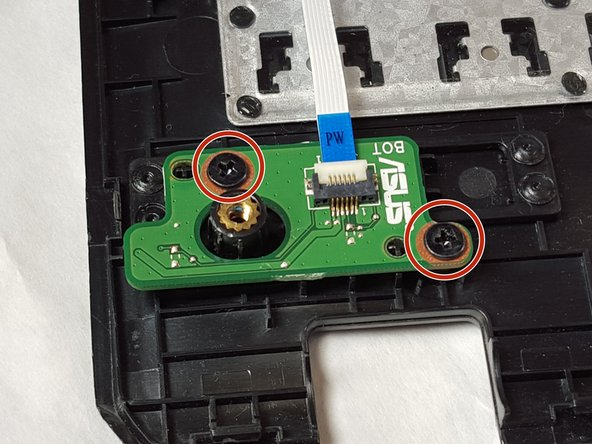 Lay the keyboard with the key-side down.  The circuit for the Power Button is just beneath the location of the button.