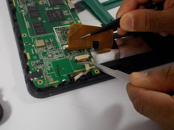 Use a second pair of tweezers to pull the gold tab connected to the camera out of the circuit board.