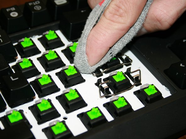 Image 2/2: Inspect the keyboard and the caps one last time to make sure there isn't anything left that could make the keys stick.
