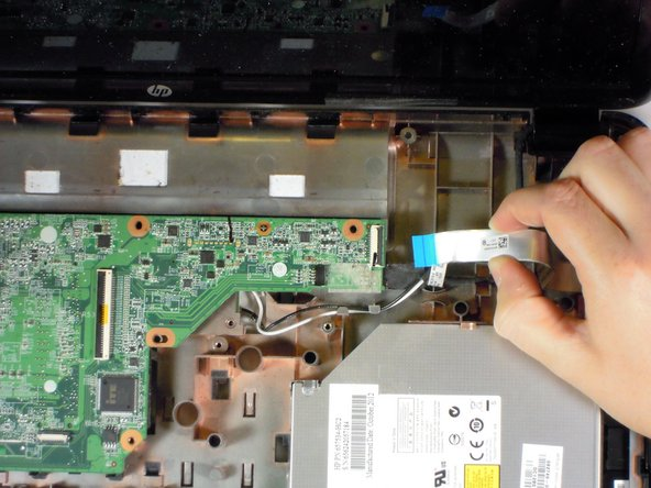 Image 3/3: Pull the silver cable away from the motherboard.