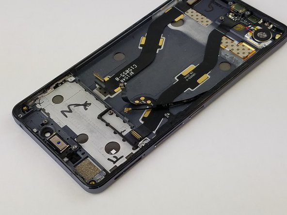 Be careful when pulling up the upper logic board, the front camera is clipped underneath and pulling too hard may damage it.