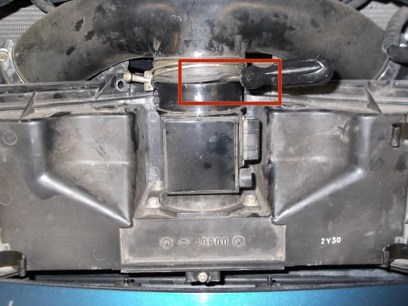 Image 3/3: Wiggle the air box cover around while lifting up on it until it is completely removed.
