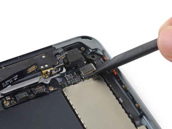 Image 2/3: Fold the rear-facing camera cable out of the way of the logic board.