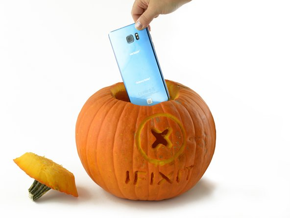 Inserting the Galaxy Note 7 into the pumpkin