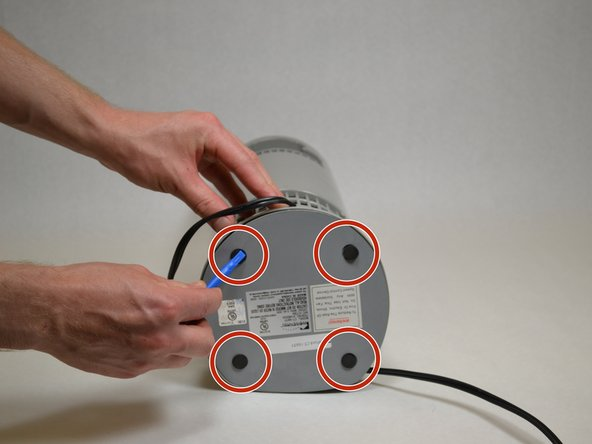 Using a plastic opening tool, remove the four small foam pieces on the bottom of the fan.