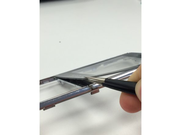 Use the needle nose pliers to pull the screen away from the front of the disassembled phone. Replace it with your new screen.