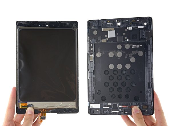 Image 1/2: Hidden behind the LCD are a few ICs: