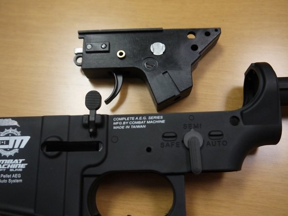 "Set the selector to ""semi"" and remove the fire control assembly from the lower receiver."