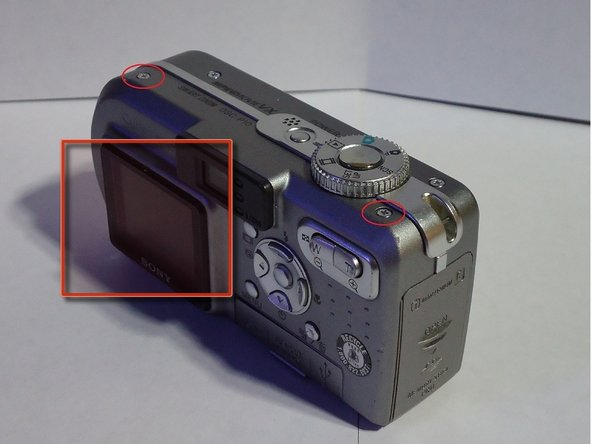 Remove the two screws on the top of the camera.