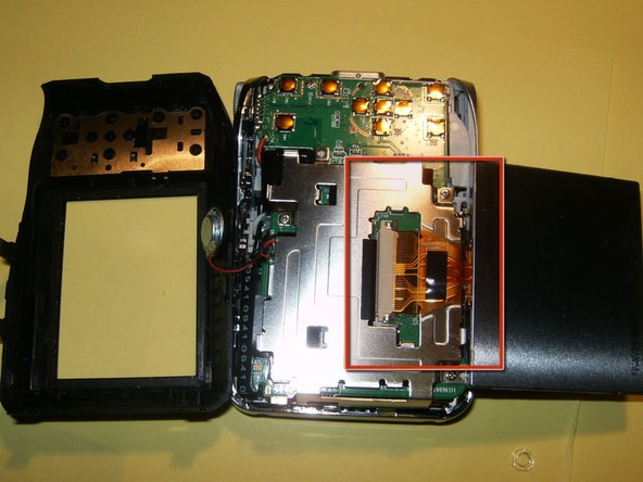 Flip the LCD to the bottom. You can not yet remove it, because it is still attached to the board.