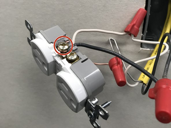 Connect and secure black insulated wire to hot side of receptacle.