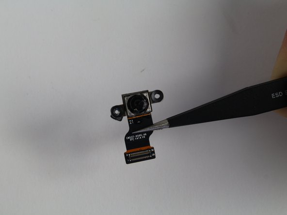 Remove the rear camera with  the tweezers.