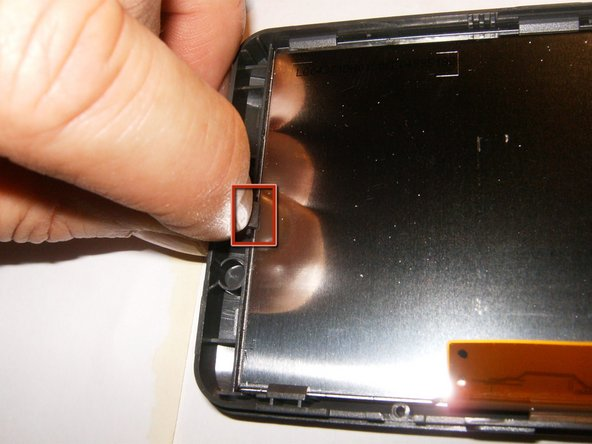 Move those tabs slightly back while applying pressure from the opposite side (front of the LCD)