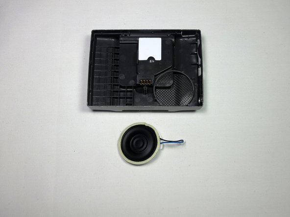 Battery is removed in the picture and is not required for the installation of a new speaker.