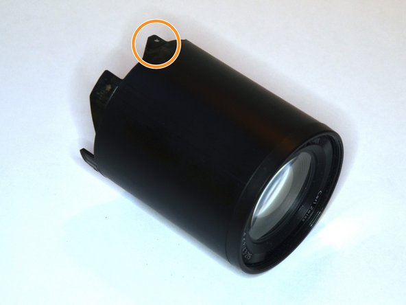 This tube has the front lens integrated and is visible to the outside when the camera is turned on and zooming.