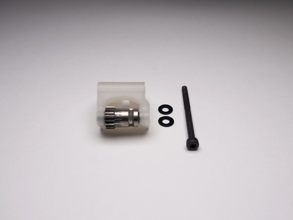 Get Idler, two nylon washers and one M3x40mm screw.