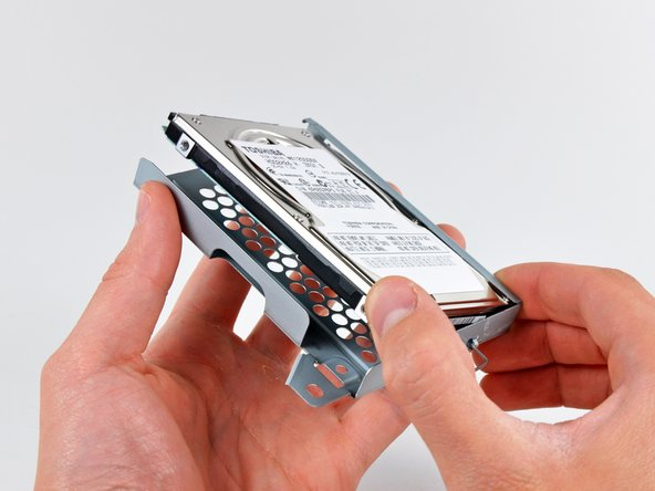 Image 1/2: Remove the hard drive from its tray.