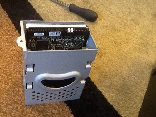 Image 3/3: And remove the hard drive bay