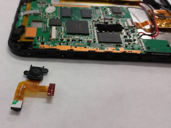 To complete removal, peel the camera off the mother board