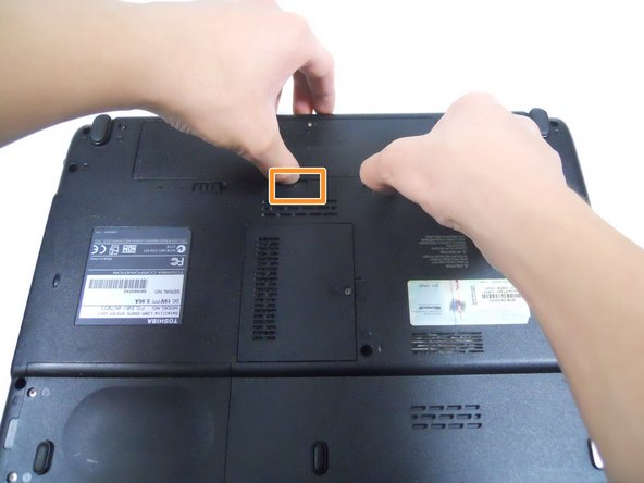 Image 2/3: Hold the release button to the right and lift the battery out of its housing.