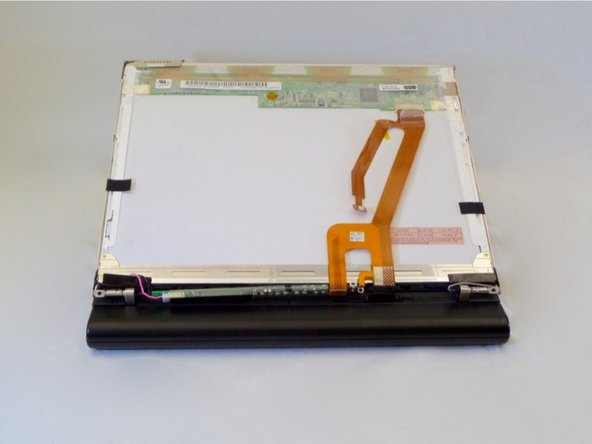 Image 3/3: Using a thumb and index finger, gently lift the LCD screen back cover away from laptop.