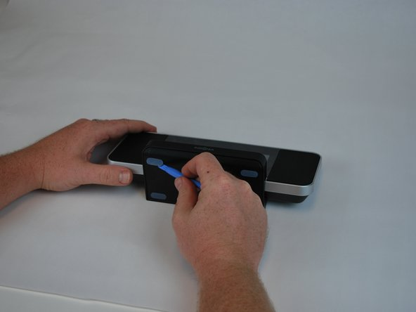 Using a plastic opening tool, peel off the adhesive gel stoppers
