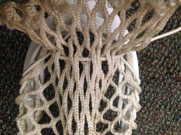 In a 10 diamond mesh row, weave the bottom string through the mesh by going in and out of each hole in a row.