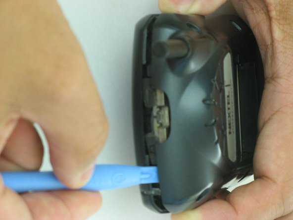 Repeat the  process of unlatching the clips for the top section of the Blackberry.
