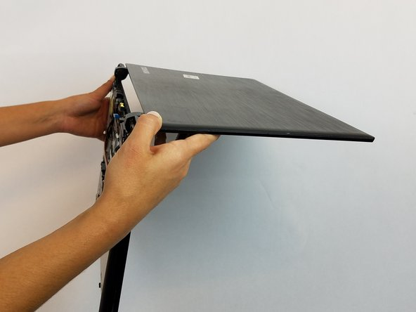 Open the laptop at a right angle to make the later removal much easier.