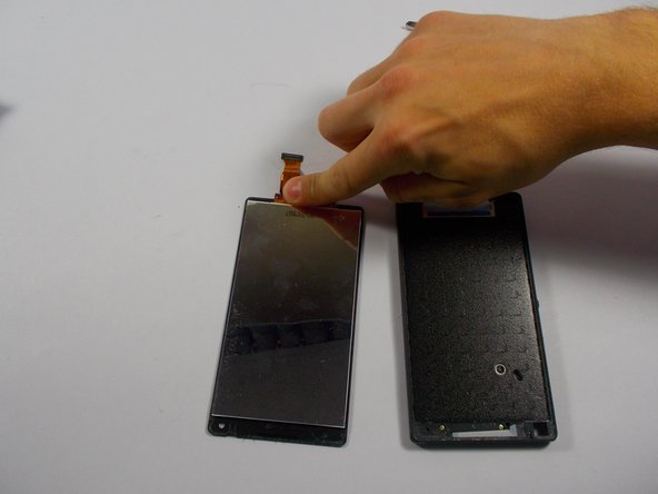 Once the you get underneath the glass, carefully pry off the adhesive tape around the edges of the phone. Once it has been taken off, carefully remove the screen from the frame and make sure the digitizer that is connected to the screen gets carefully taken out.