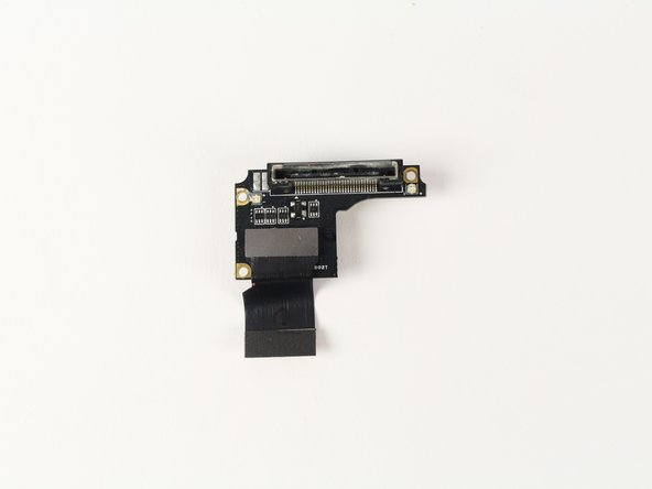 Image 2/2: Remove the media adapter from the motherboard.