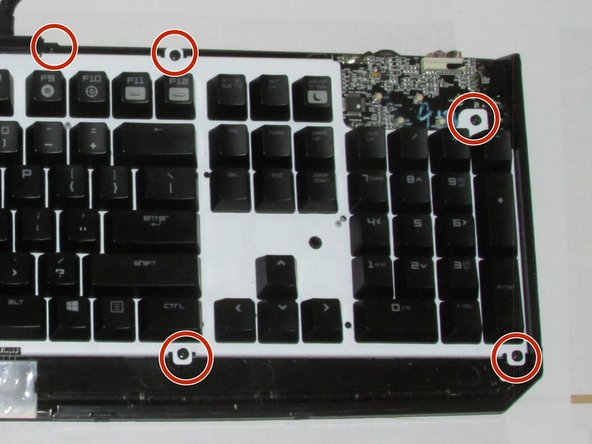Using the Phillips #0 Screwdriver, remove the  ten 10mm screws that are indicated by the red markers.