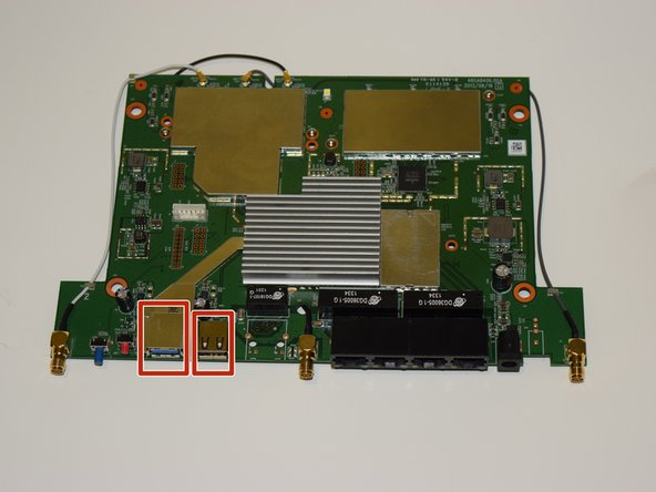 Locate the USB ports on both sides of the router motherboard. There are six points on the reverse side where the USB ports are soldered onto.