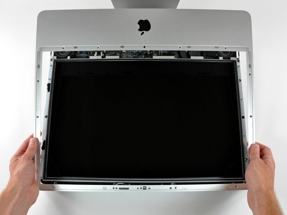 Image 2/2: Once the top edge of the front bezel has cleared the rear case, rotate the front bezel toward the stand and lift it off the rear case.