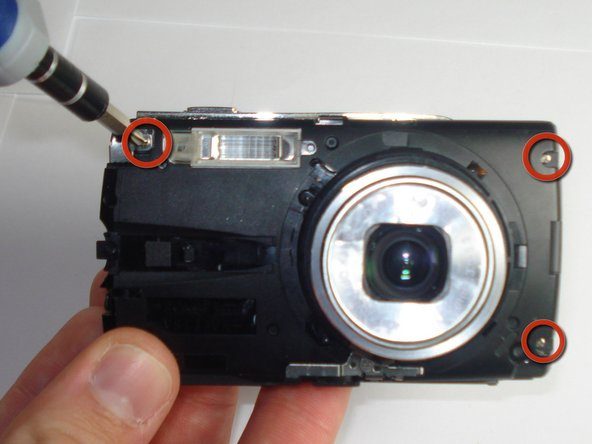 Remove 3 screws from the front of the camera using a #00 screwdriver.
