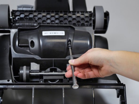 Use a 3.0 Hex bit screwdriver to remove the two 20mm screws on the bottom of the motor cover.