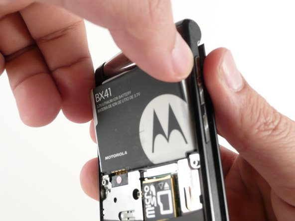 To remove the battery, grasp its edges pull away from the phone.