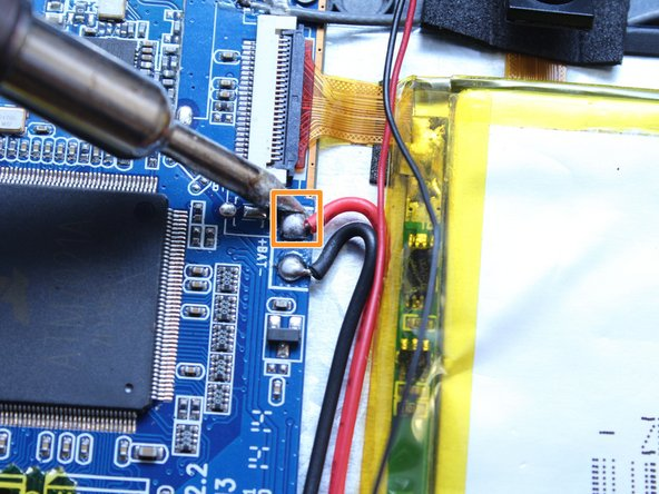 Image 2/2: Use pliers to pull the wire from the board